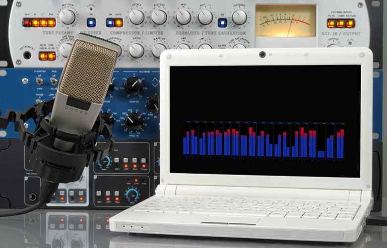 Audio setup containing microphone, laptop and other professional sound design devices